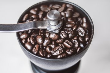 Coffee grinder with beans in it