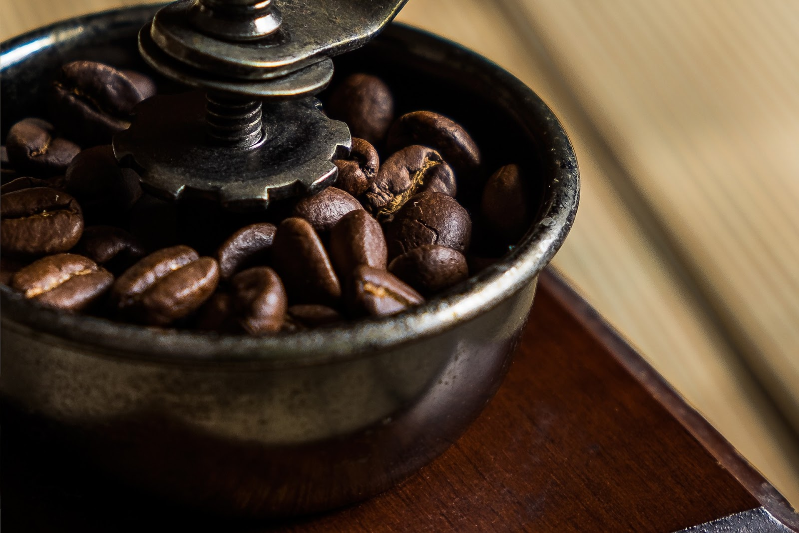 Closeup of beans in a coffee grinder