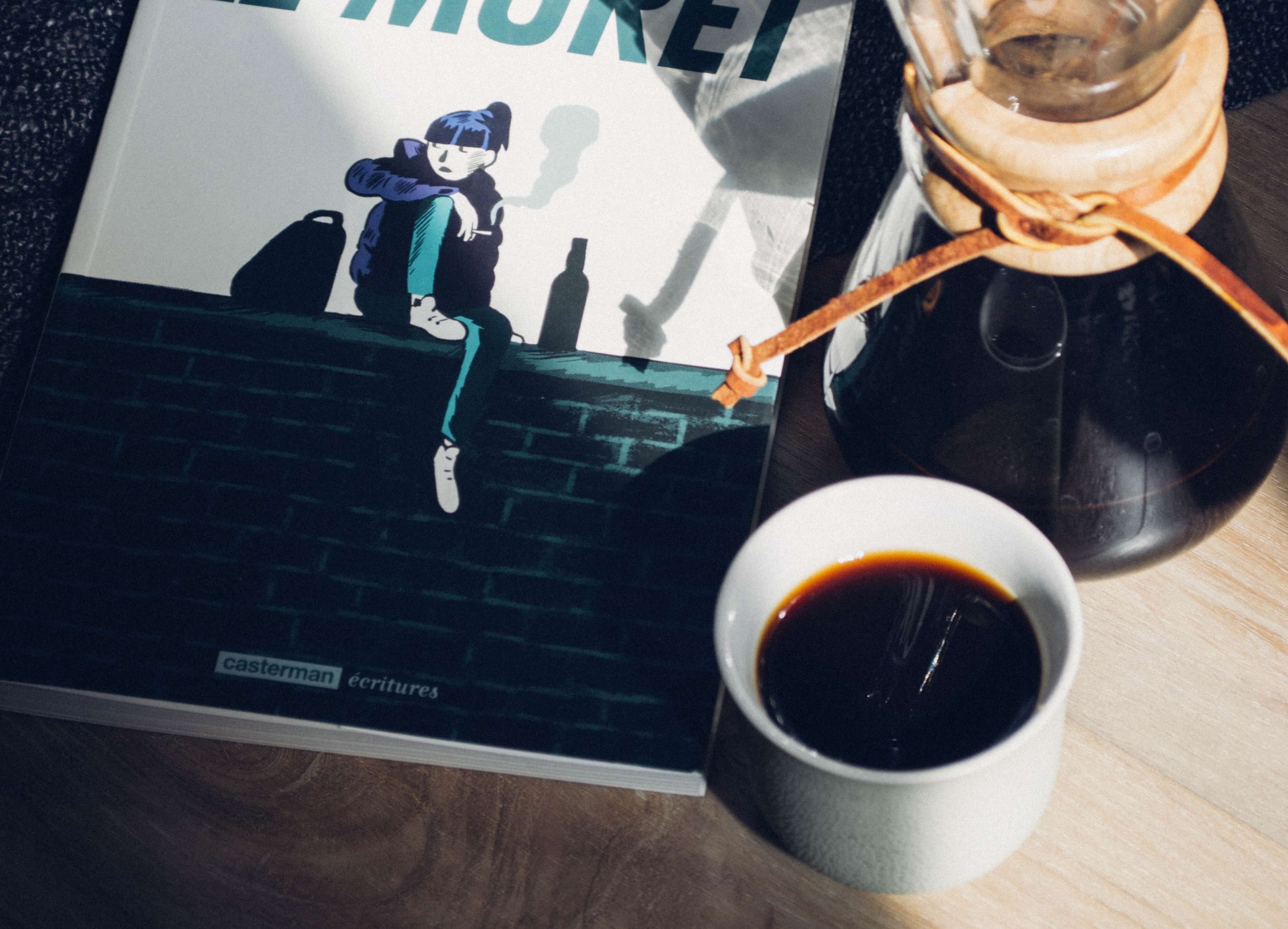 Black coffee with a Chemex and a magazine